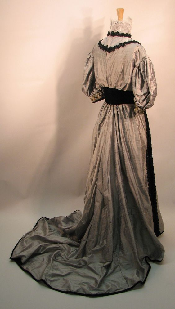 Back view of the 1901 dinner dress showing the elaborate train.
