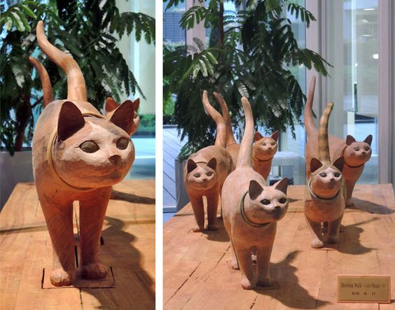 Carved Walking Cats.: