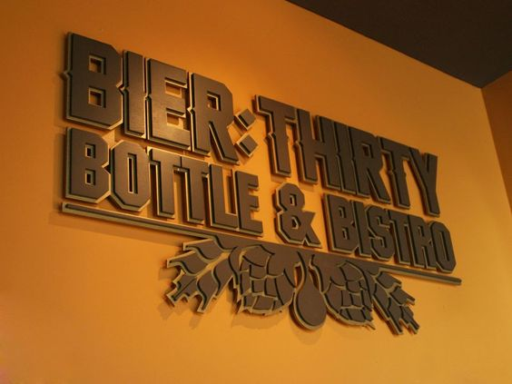 Custom Wooden Sign | Font: Per Customer Logo. Color: Metallic Gold & Spice Brown