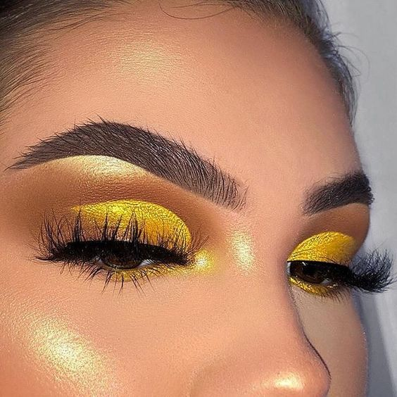 Yellow toned eye makeup