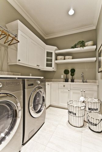 Love the spacious laundry room, cabinets should go all the way to the ceiling, though...