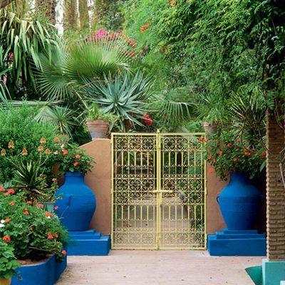 Blue urns flanking entrance gates