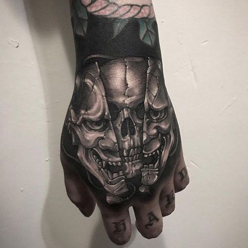 Evil Skulls One On Each Of Guy S Hands One Has A Orange Glow And The Other Is Blue Skull Hand Tattoo Tattoos Hand Tattoos