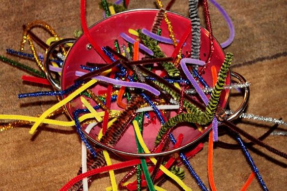 a fine motor activity - sticking pipe cleaners through holes in a colander. Holds a preschooler attention for quite some time!