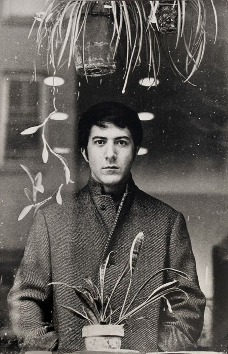 Young Hoffman with plants.