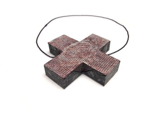 "Sharon Massey  Brickwork X necklace .     ""My work is inspired by the post-industrial landscape of Pittsburgh and surrounding areas. Through use of both labor and materials I pay homage to the region's blue-collar past."":"