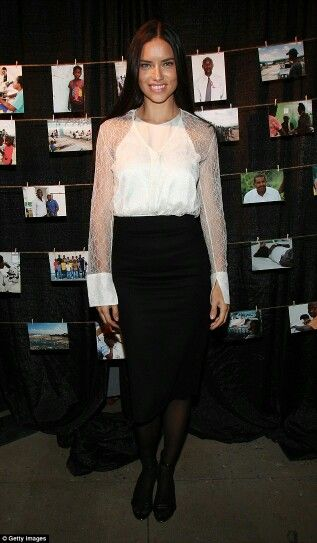So demure! Adriana Lima wears sheer lace blouse as she shows support for Haiti's St Luke's Hospital in New York City