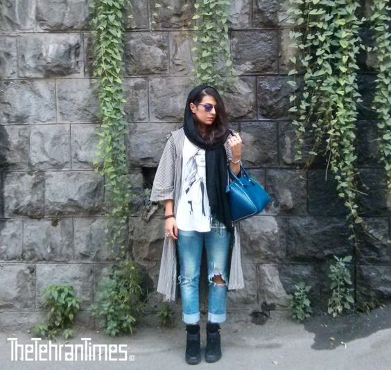 Tehran street style -Statement ripped jeans with black and white outfit