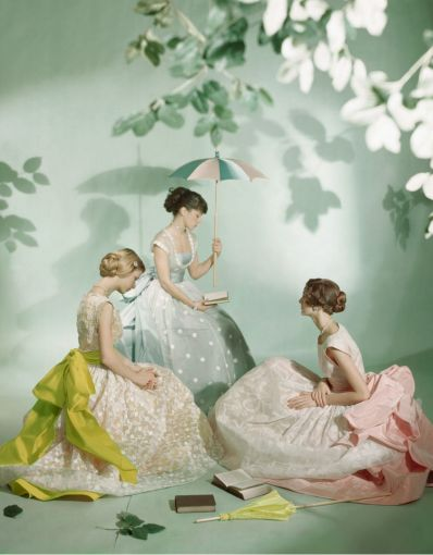 Three models photographed by Cecil Beaton in 1948 wearing Ladurée macaron colours.
