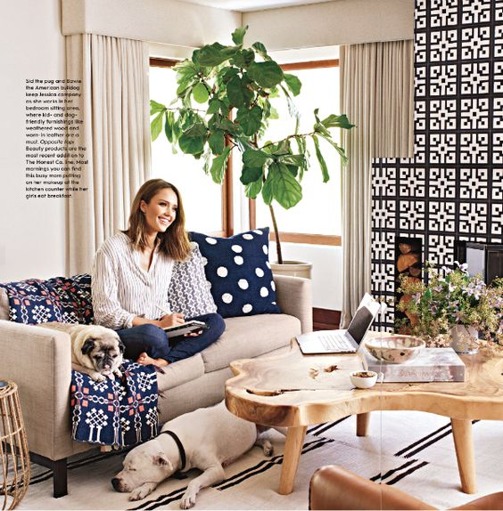 The simple backgrounds and mix of bold patterns in the sitting area of Jessica's master bedroom are amazing, as is that natural, chunky wood coffee table.