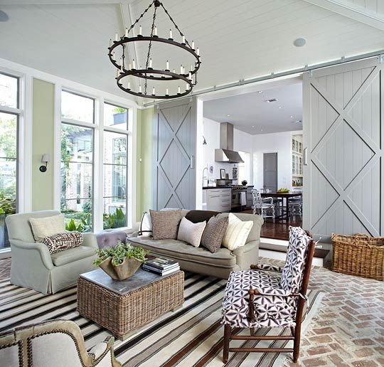 "A Williams-Sonoma striped rug set on pavers neutralizes walls painted Farrow & Ball's ""Cooking Apple Green."" - Traditional Home ® / Photo: Werner Straube:"