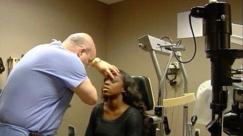 Doctor looking at Trinity Eye