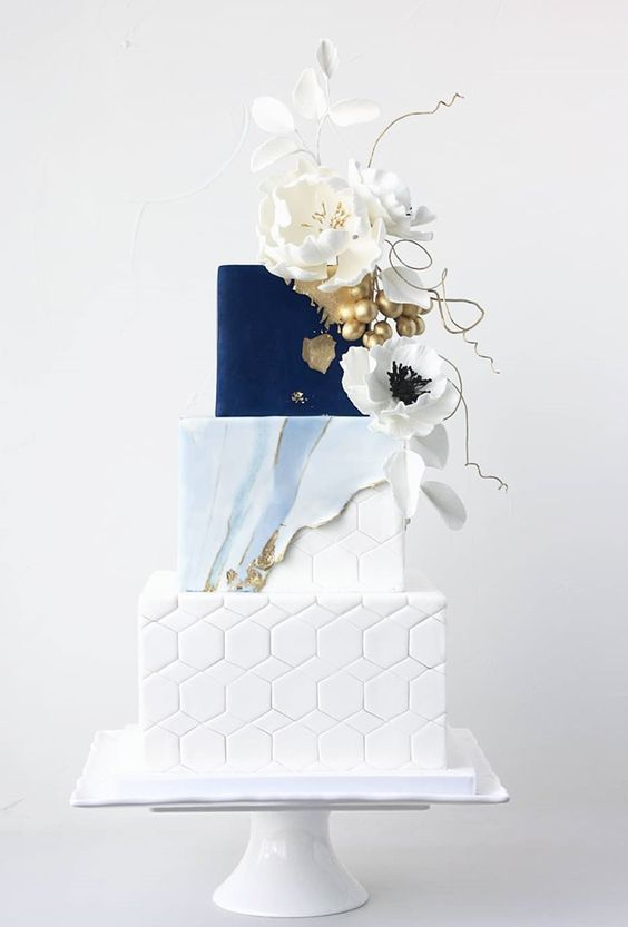 A Sophisticated Wedding Cake With A White Hex Watercolor Blue And