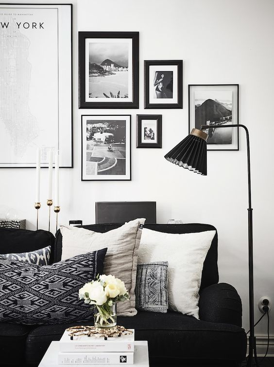 Sitting room in a Swedish home with dramatic black accents. Anders Bergstedt for Entrance.: