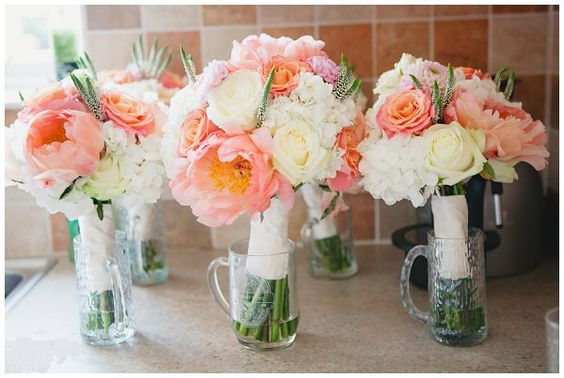 coral rose and peony bouquets for weddings  | The button holes tied in to the coral country garden wedding with ...