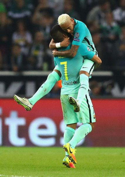 Arda Turan of Barcelona celebrates with team-mate Neymar after scoring their first goal during the UEFA Champions League group C match between VfL Borussia Moenchengladbach and FC Barcelona at Borussia-Park on September 28, 2016 in Moenchengladbach, North Rhine-Westphalia.