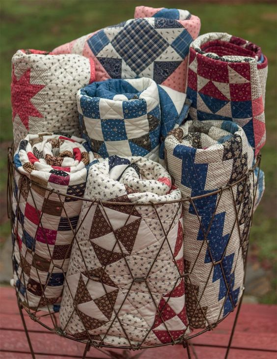 What a gorgeous bundle of antique quilts! From the book Remembering the Past by Julie Hendricksen.