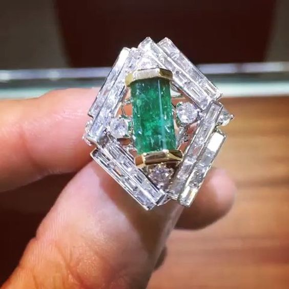 An exquisite #rough #colombianemerald #ring containing 65 #diamonds that total…