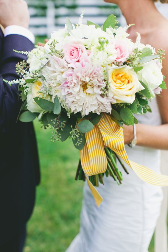 Elegant, gorgeous bridal bouquet with yellow stripped ribbon