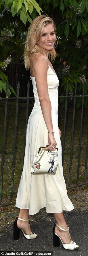 Glamorous: Sienna looked the picture of elegance in her gorgeous gown, which clung to her ...