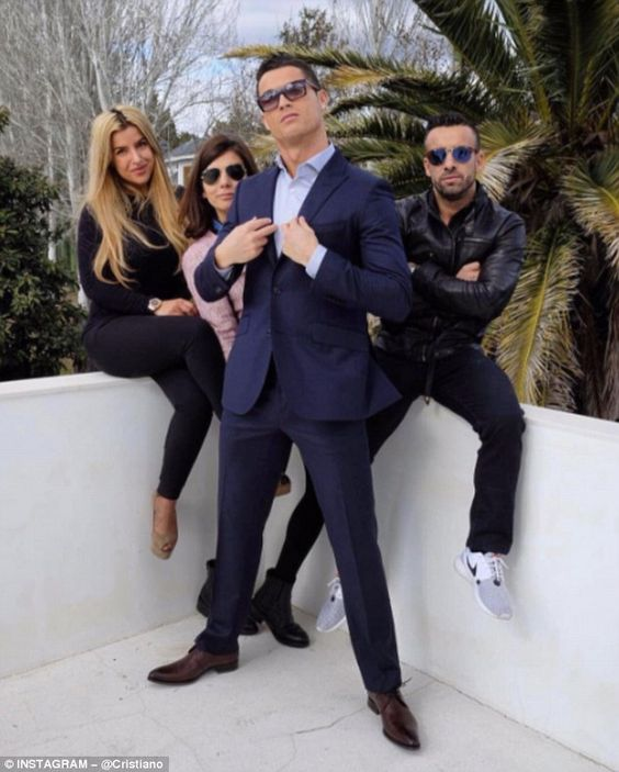 Ronaldo poses in front of Regufe and the rest of his CR7 management team...