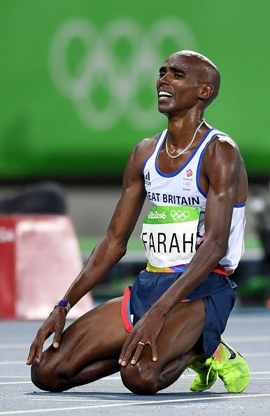 Mo Farah of Great Britain celebrates after winning the Men's 10000m on Day 8 of the Rio 2016 Olympic Games at the Olympic Stadium on August 13...
