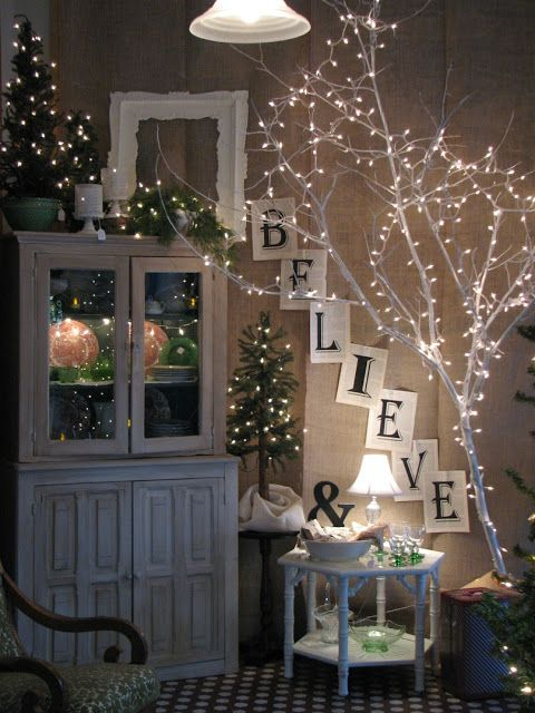 Tree limb, spray painted and white lights - omg, I'm totally painting the branches in a dark green!!!