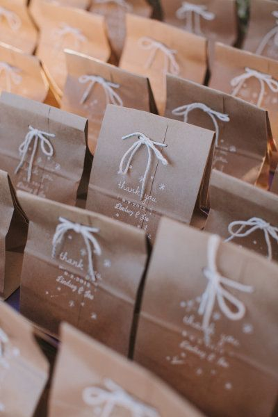 "Bake Sale Packaging! - handstamped brown paper bags with blog listed on bag and ""The World Race -- 11 in 11"":"