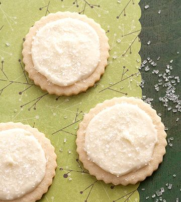 These nutmeg sugar cookies are topped with eggnog icing and sprinkled with coarse sugar. More recipes: http://www.bhg.com/christmas/cookies/favorite-christmas-cookies/