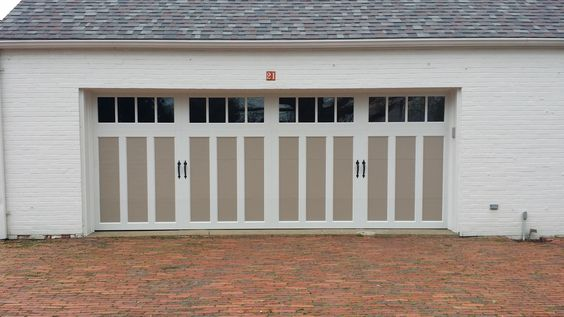 Clopay coachman collection steel carriage house garage for Steel garage doors that look like wood