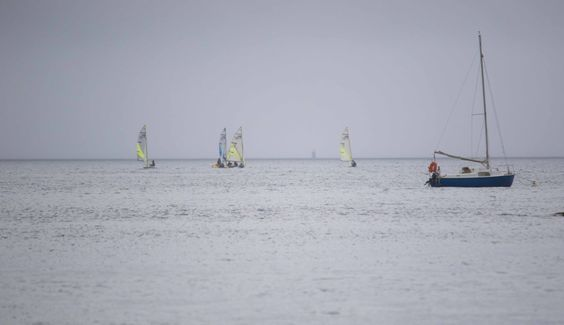 Sailing boats in the Breton mist