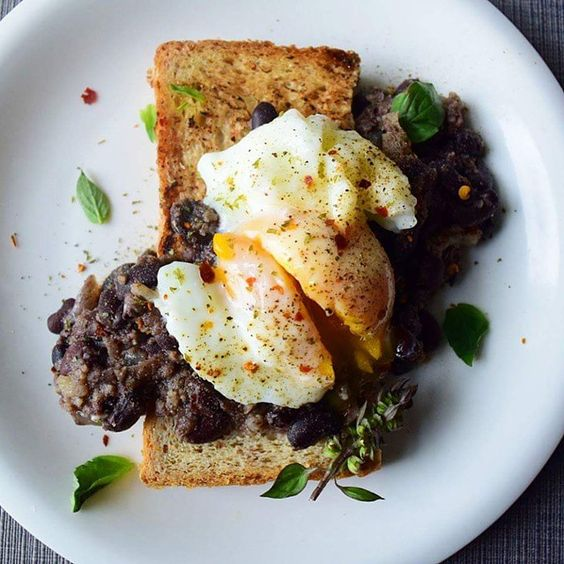 Leftover beans and poached egg on toast. Can you say late breakfast?