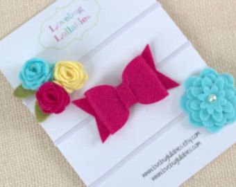 Felt Heart and Bow Headband or Hair Clip SET OF 2  ♥♥ Please see shop homepage announcement for current make time ♥♥ Pink & white hearts & a bow tie make an adorable and romantic hair accessory set for any baby, child, or adult. Made from a wool felt blend and secured to either skinny elastic headbands or ribbon lined alligator clips.   (1) Heart Trio measures just under 3 wide x 2 tall (1) Bowtie measures 1.25 x 2.5   ♥♥ HEADBAND SIZES ♥♥ - Newborn (13 inches) - 3 - 6 Months (14.5 inches)…