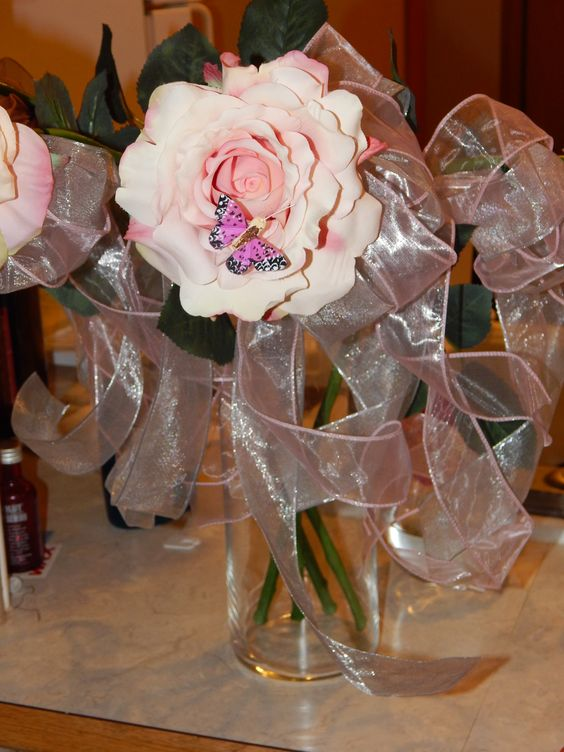 Single large flower with butterfly for brides maids