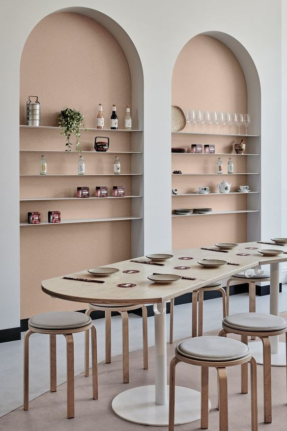 The arches, the table ends and feet, the stools... curves are everywhere in this #restaurantinterior