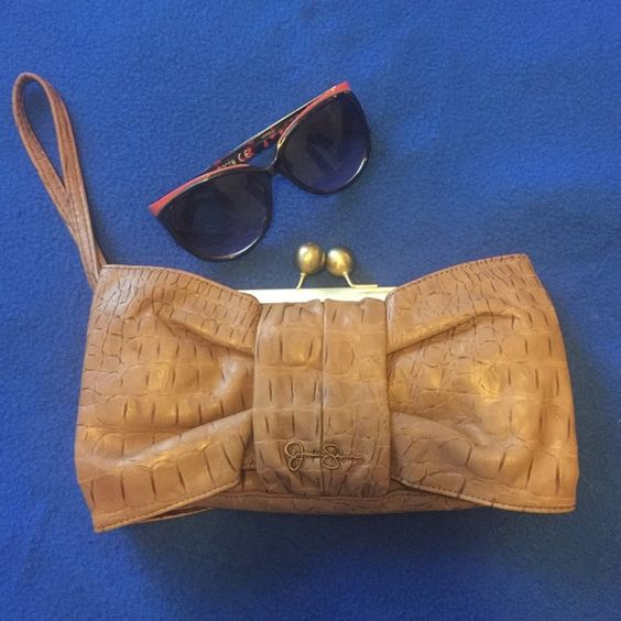 Clutch Beautiful bow like Jessica Simpson Clutch. Brown in color, in good condition. Previously loved! Jessica Simpson Bags Clutches & Wristlets