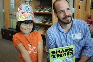 """The Tobias Elementary School library hosted children's book author Chris Barton recently, the Explorer PALS, Kinder, 1st, and 2nd-Grade all getting the chance to hear the acclaimed Sulphur Springs, Texas, native talk about what goes into writing a book. Students prepared sharks and trains head crowns to wear to the talk, paying note to the author's humorous book, Shark vs. Train."""