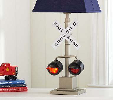 Has 3 settings light with red flashing lights, light only, and red flashing lights... AWESOME!!    Railroad Crossing Base #PotteryBarnKids