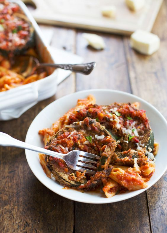 Zucchini Parmesan (lasagna). Baked zucchini with penne pasta and tomato sauce