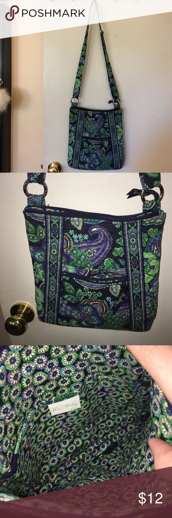 Vera Bradley crossbody Very lightly used. There's two extremely tiny spots in the inside of the back can barely even see them I couldn't even see it in photo. Great shape. Adjustable straps. Vera Bradley Bags