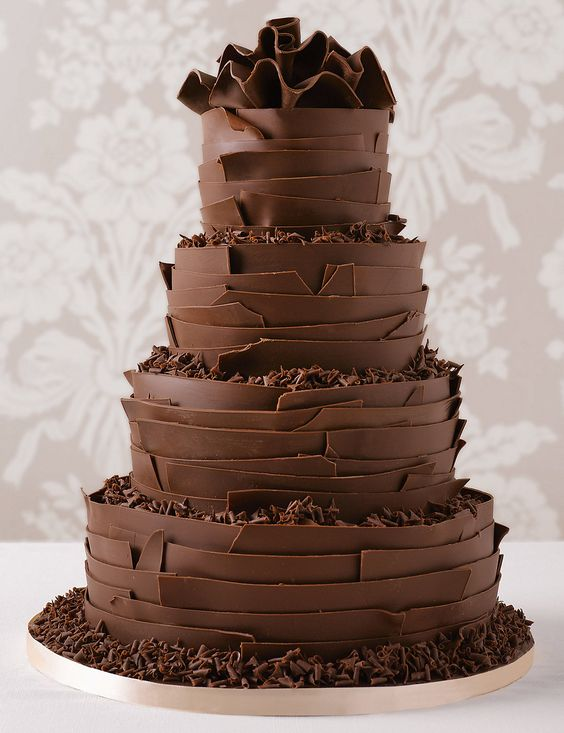 The wedding cake to really give the wow factor! This decadent four tier chocolate cake is smothered in chocolate ganache and hand finished with ribbons of chocolate.: