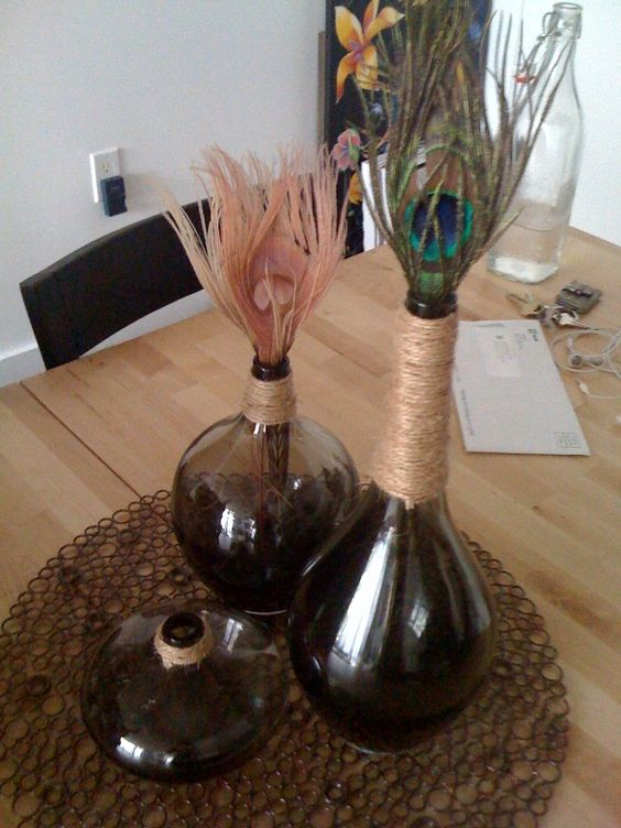 I like the idea of peacock feathers in bud vases.