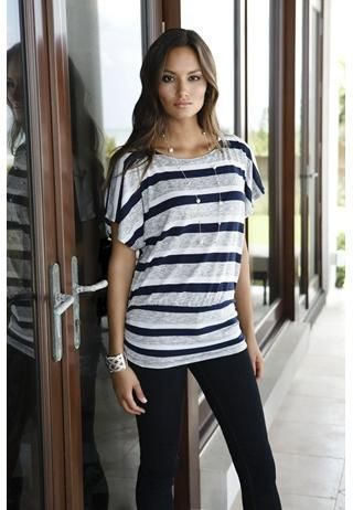STRIPED SHORT SLEEVE DOLMAN TOP  Striped short sleeve dolman top. Semi-sheer striped top with short dolman sleeves. Banded hem is slightly ruched at the sides. Domestic poly/rayon/nylon. Sizes S, M, L. Navy stripe (NV). 5064 $16.90.