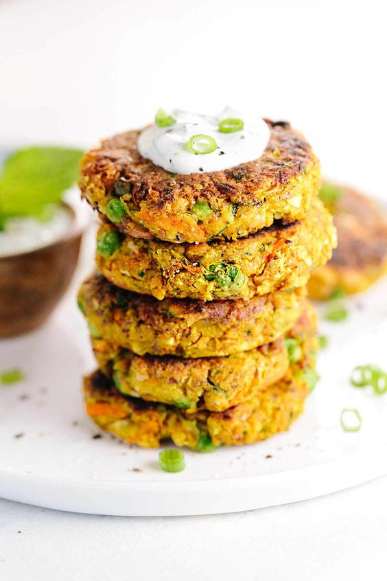 Indian-Spiced Vegetable Cakes with Chickpeas - Each fritter is packed with bold flavor and wholesome ingredients in each bite! Served with a creamy mint yogurt sauce.   jessicagavin.com