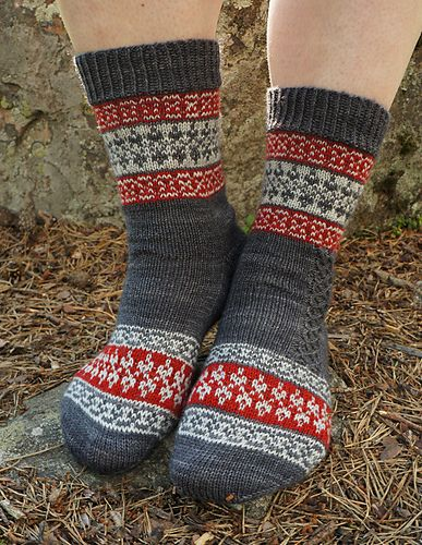 Echoes from Karelia sock pattern is a tribute to my mother's North Karelian heritage. All the stranded patterns used are 4-stitch repeats, which makes the design easy even for less experienced knitters: there are no long yarn floats to tie and the total stitch count can be easily adjusted by 4-stitch intervals.: