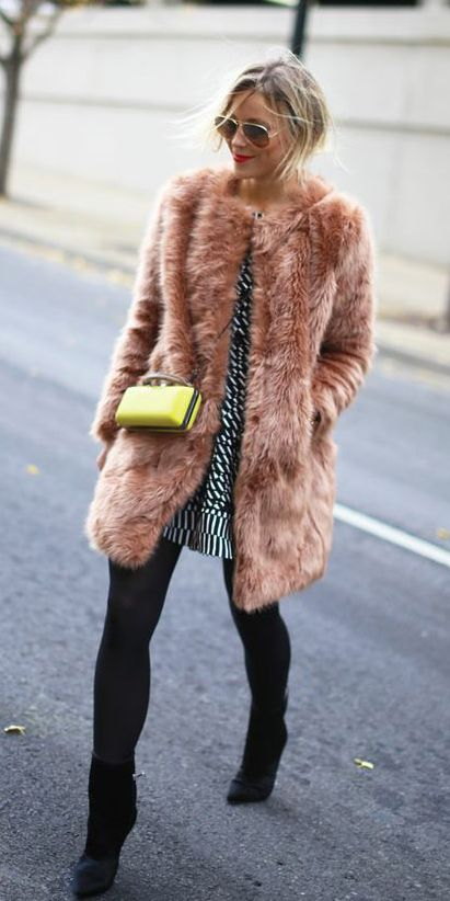 Finish your holiday dress look with a fab faux fur coat. | Warm