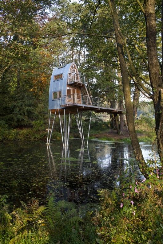 Rounded Treehouse Tower Solling by Baumraum Architects in Uslar, Germany built in 2010 over a man made pond. Photos © Markus Bollen: