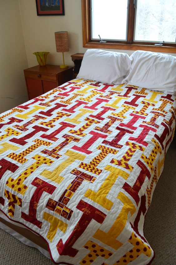 This listing is for quilts made to order!  Beautiful Iowa State Cyclones quilt hand made by me! The fabrics are a collection of red, yellow, red and yellow, and cyclone print fabrics against a white cotton background. The backing is 100% cotton fabric. Batting is warm and natural 100% cotton.  This quilt is machine quilted in an intricate pattern with premium thread. Machine wash on cold and tumble dry to clean. This quilt would be great for a baby quilt, a college dorm quilt, or for the rece...