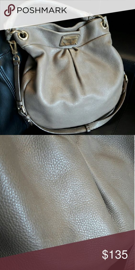 MARC BYARC JACOBS Classic Q Hillier Great neutral color for Fall or any season.  Color is Taupe. Beautiful leather and Can be used as a crossbody. Comes with original dust bag. Shoulder straps shows normal wear, but nothing too bad. No interior stains or tears. Flaw: 2nd pic shows a waterspot. Barely visible when worn. No trades. Accepting only reasonable offers. Pls. Consider posh fees😊 Marc by Marc Jacobs Bags