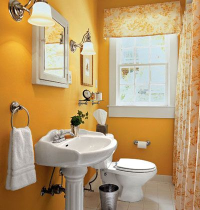 <3    A bathroom with yellow walls and yellow accents curtains.